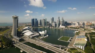 Elevated downward view over the City Centre and Marina Bay, Singapore, South East Asia, Time lapse