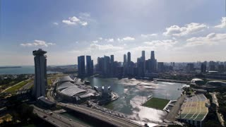 Elevated downward view over the City Centre and Marina Bay, South East Asia, Time lapse