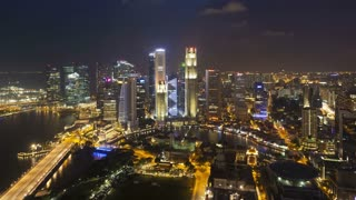 Elevated illuminated view over the City Skyline and Financial district, Singapore, Southeast Asia, Asia, Time lapse