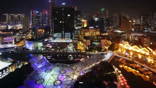 Elevated illuminated view over the Entertainment district of Clarke Quay, the Singapore river and City Skyline, South East Asia, Time lapse