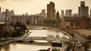 Elevated view along Suzhou Creek, new Bridges and City skyline, Shanghai, China, Asia, T/Lapse