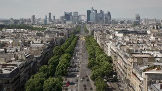 Elevated view from the top of the Arch de'Triomphe along the Ave de La Grande Armee towards the financial and business district of La Defense, Paris, France - T/lapse