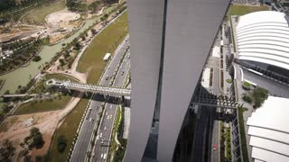 Elevated view over the East Coast Parkway from the Marina Bay Sands,  South East Asia, Time lapse