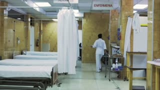 Empty bedrooms of an hospital in Latin America