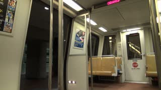 Empty Metro Train Doors Open at Station