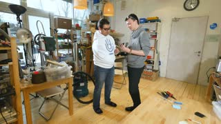 Engineers in lab discuss robotic bionic arm made on 3D printer