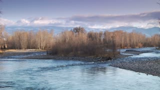 Epic Wide Shot  Of Man Flyfishing In River In Wintertime