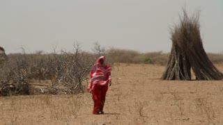 Ethiopian Woman Walks In Wind