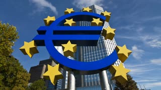 Euro currency sign in front of the European Central Bank in Frankfurt Germany, Europe, T/Lapse