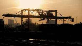 export import. logistics. silhouette. time lapse. industrial cranes moving