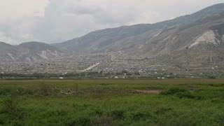 Extensive Shantytown And Green Fields In Haiti