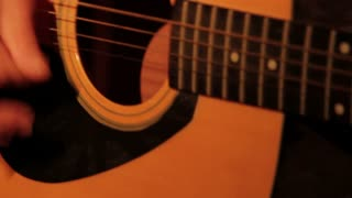 Extreme Closeup of Man Strumming Guitar