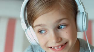 Extreme closeup portrait laughing girl in headphones. Zooming