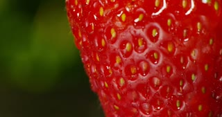 extreme macro of strawberry dropping fresh water