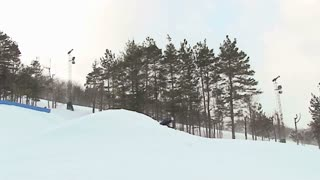 Extreme skier throws a 360 off jump