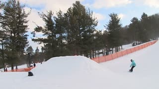 Extreme snowboarder pulls a backflip 720 off jump