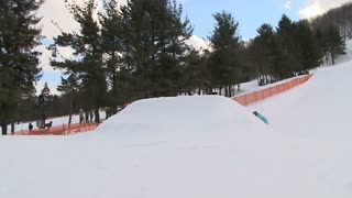 Extreme snowboarder throws huge backflip off jump