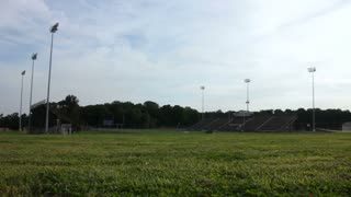 Extreme wide dolly of an empty high school football stadium.