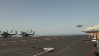 F-18 Hornet landing as USS Harry S. Truman Launches and Recovers Aircraft