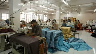 Factory workers using sewing machines in a garment factory, Rajasthan, India