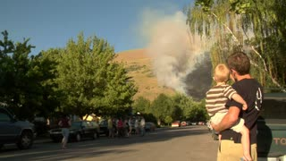 Families Watch Forest Fire Burning Near Neighborhood