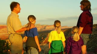 Family Admires Sunset View In Capitol Reef National Park