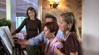 Family at Piano Singing Together 2