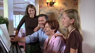 Family at Piano Singing Together 3
