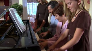 Family at Piano Singing Together 7