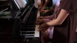 Family at Piano Singing Together 9