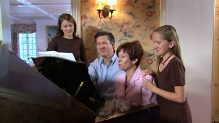 Family at Piano Singing Together