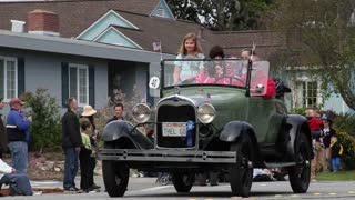 Family In Old Model A Ford In Parade