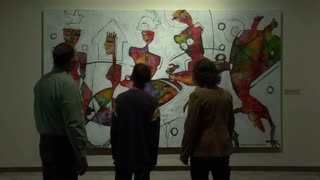 Family Looks At Abstract Painting