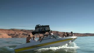 Family On Speedboat Pulls Wake Boarder Slow-motion