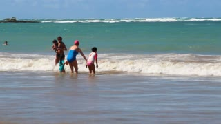 Family Playing In Ocean Waves