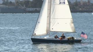 Small sailboat with family onboard