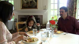 Family Sits Down to Eat a Meal Together 2