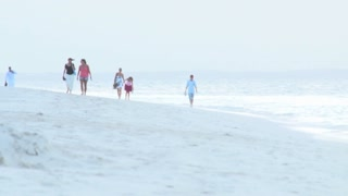 Family Walking in Sand on Beach