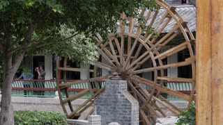 Family Walks Around Chinese Water Wheel