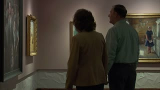 Family Walks Through Art Gallery