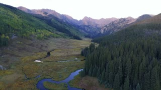 Fast flight backwards over Piney Lake at sunset in Vail Colorado