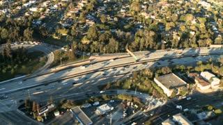 Fast Flyby Across Highway Aerial