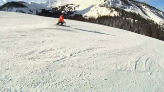 Fast skier carves down ski slopes