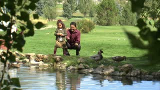 Father and Daughter Walking Near Pond 2