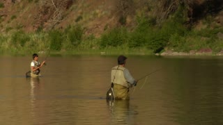 Father And Son Flyfishing In Smooth River