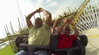 Father and Son on Roller Coaster