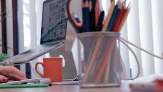 Female designer works at her home office desk
