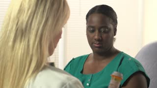 Female Doctor discussing prescription with Patient - dolly