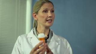 Female doctor talking to patient about prescription - dolly shot