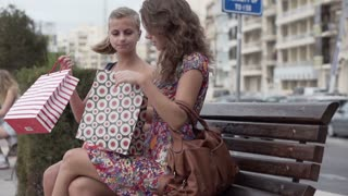 Female friends after shopping in the city, slow motion shot at 240fps